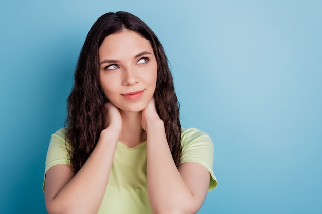 Photo of dreamy ponderous minded lady arms neck look empty space think ideas on blue background