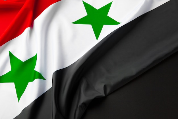 Photo of fabric syria flag close up