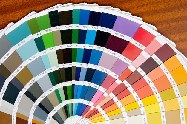 A photo of a fan of colors in the table