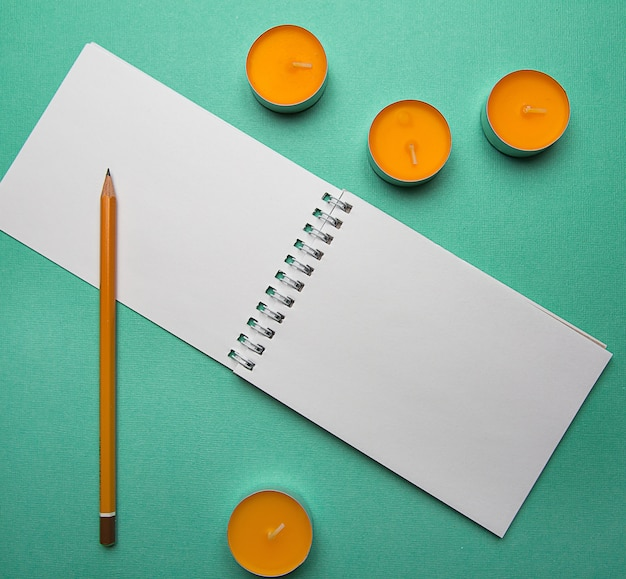 Photo flat lay abstract composition top view open notebook and lsit paper