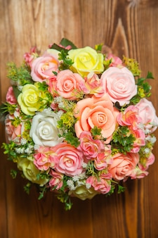 Photo flat lay bouquet of flowers from the soap in a red-pink color top view