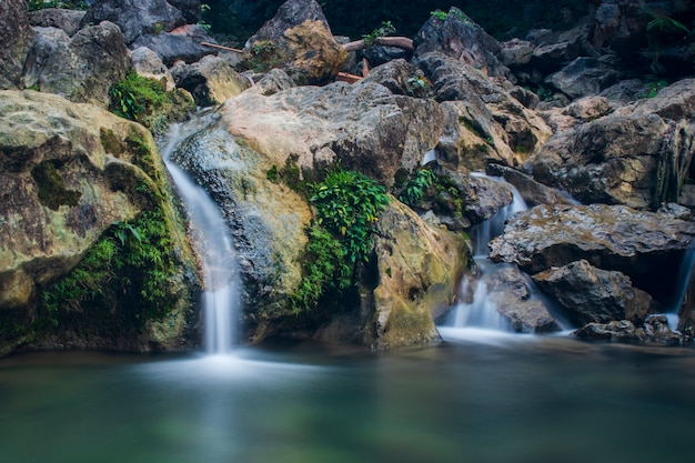 Photo of flowing water at a very beautiful pudeng waterfall tourist spot in aceh besar district