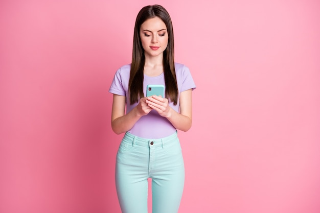 Photo of focused girl use smartphone follow social media information feedback wear good look violet outfit isolated over pastel color background