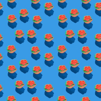 Photo in the form of a seamless pattern red flowers in a green basket with shadows on a colored blue