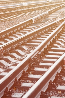 Photo fragment of the railroad tracks in the rainy weather