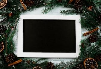 Photo frame between fir twigs