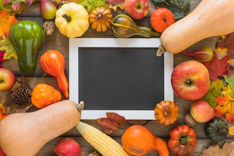 Photo frame between fruits and vegetables