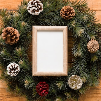 Photo frame between wreath with snags