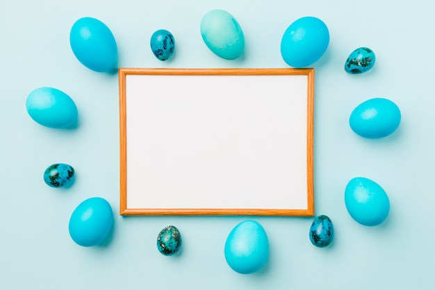 Photo frame between blue set of easter eggs
