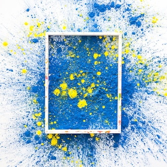 Photo frame on blue and yellow bright dry colors
