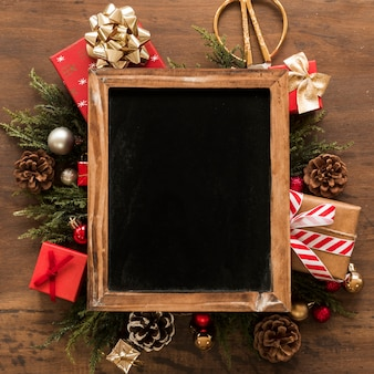 Photo frame between christmas decorations