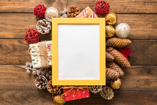 Photo frame between christmas toys