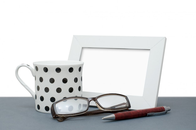Photo frame, coffee cup, glasses