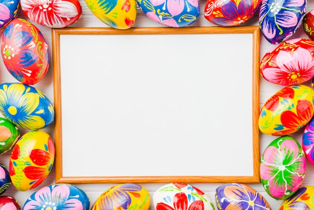Photo frame between collection of easter eggs