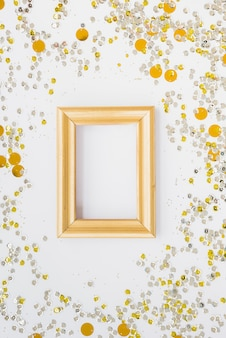 Photo frame between colourful confetti