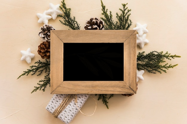 Photo frame on composition of snags and coniferous twigs