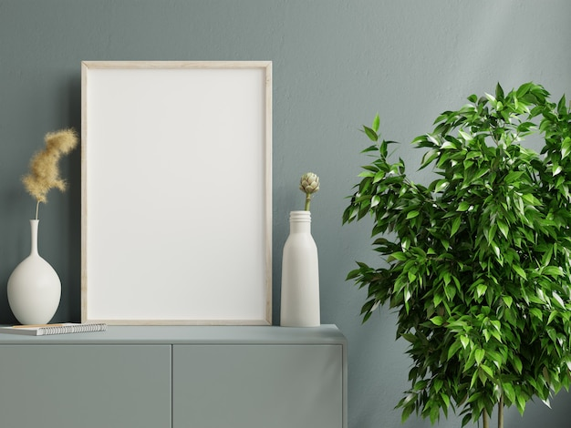 Photo frame on the dark green cabinet with beautiful plants