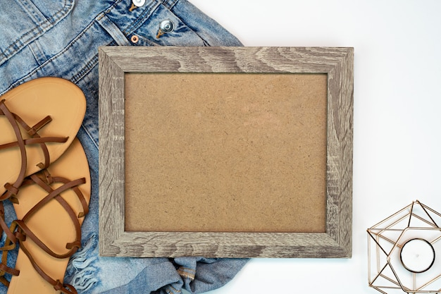 Photo frame mock up with jeans shorts and beach sandals