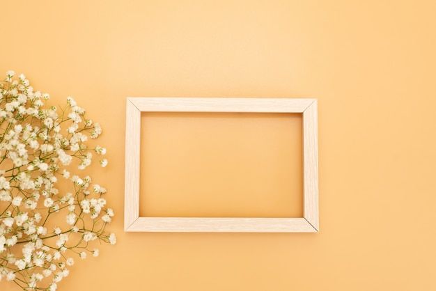 Photo frame mock up with space for text, golden confetti on white background. lay flat, top view.