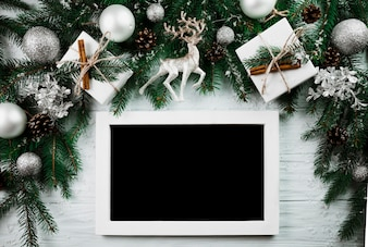 Photo frame near Christmas twigs