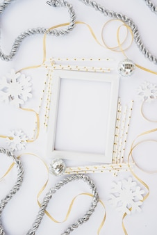 Photo frame between tinsel and ribbons