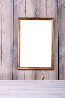 Photo frame on the wall on the background of wooden slats