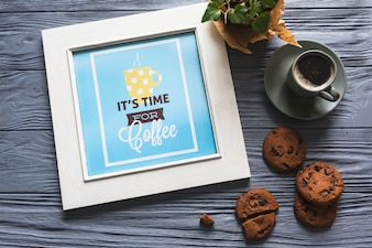 Photo frame with coffee cup and cookies