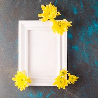Photo frame with flowers on grunge dark-blue background