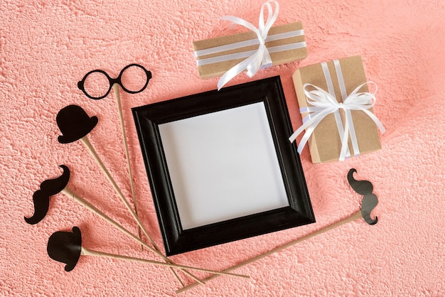 Photo frame with gifts for father's day.