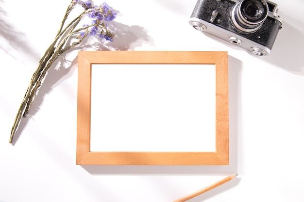 Photo frame with lavender and camera on table