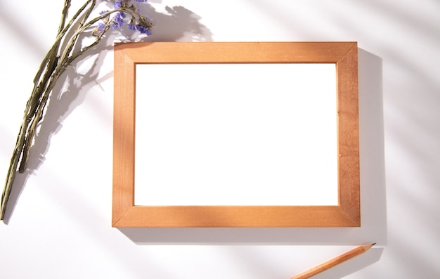 Photo frame with lavender and pencil on table