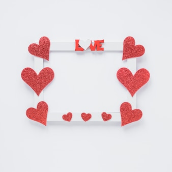 Photo frame with love title and heart symbols