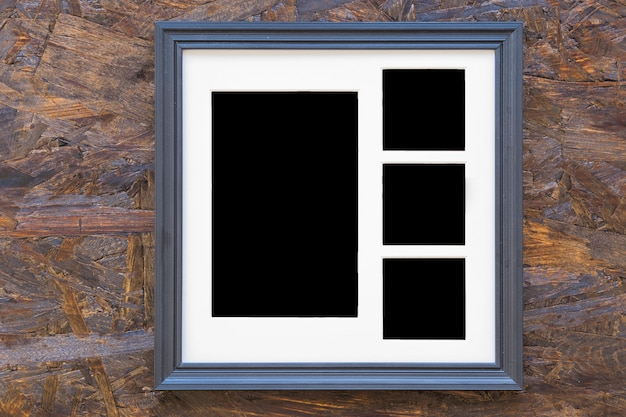 Photo frame on wooden textured background