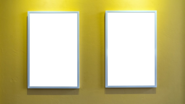 Photo frame over the yellow wall background, interior gallery