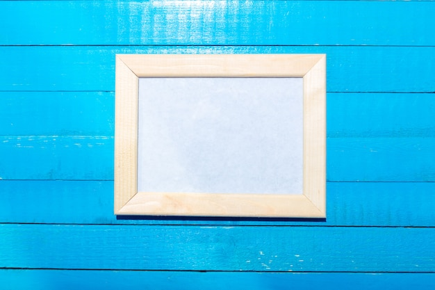 Photo frames on the wooden wall background