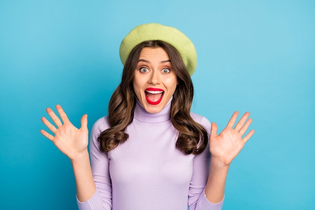 Photo of funky traveler lady toothy beaming smiling open mouth excited feelings wear green beret hat purple turtleneck isolated bright blue color wall
