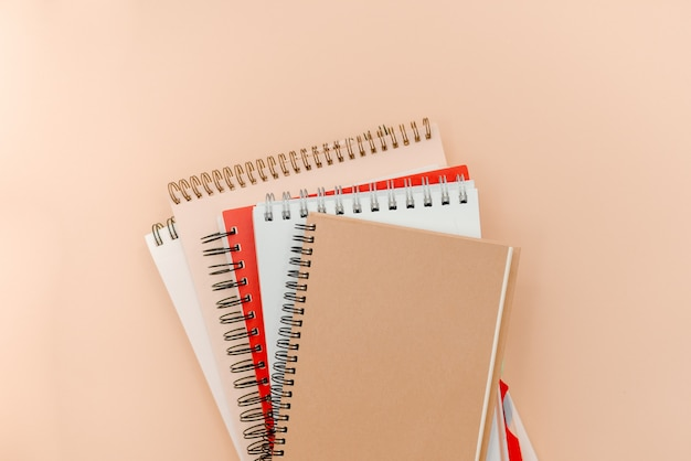 Photo of  glasses and notepads  on a beige abstract background