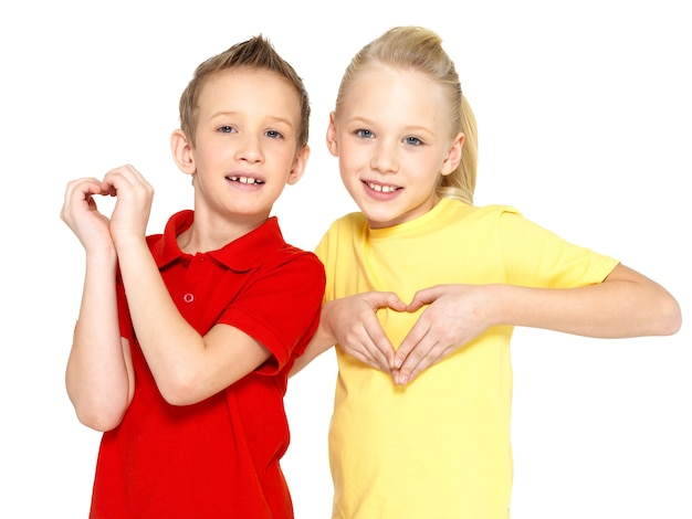 Photo of happy children with a sign of heart shape  isolated on white background