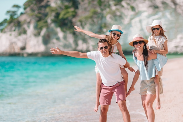 Photo of happy family having fun on the beach. summer lifestyle