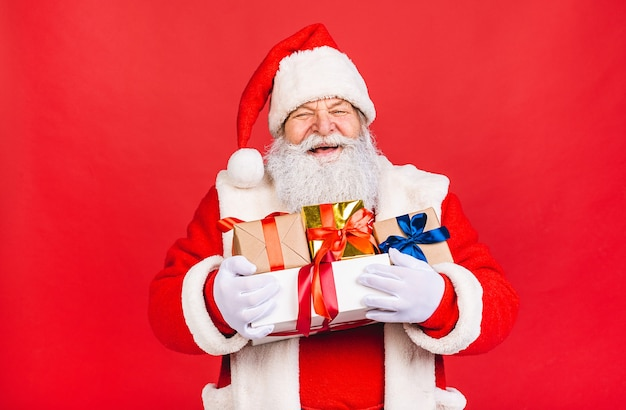 Photo of happy santa claus with present gift boxes