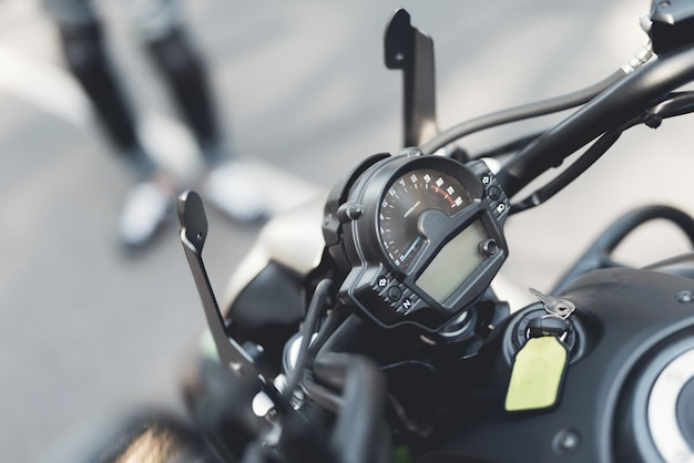 On photo the helm of motorcycle with control buttons.