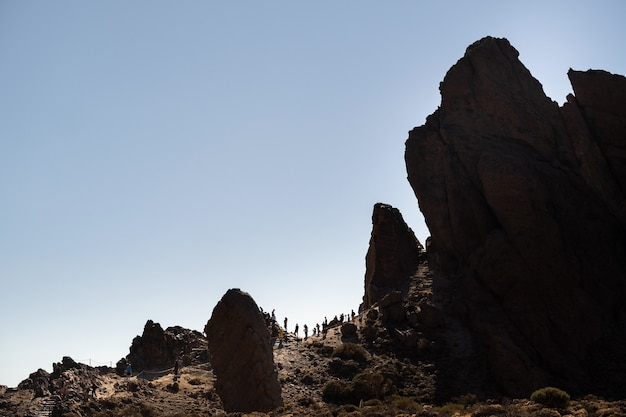 Photo of high volcanic rock formations on the slope of the teide volcano, tenerife