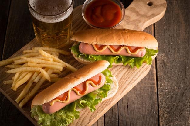 Photo of  hot dog with yellow mustard and ketchup.