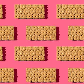 Фото в виде бесшовного узора. чипсы оранжевого цвета для здорового питания
