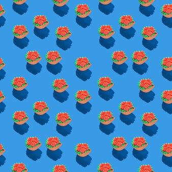 Фото в виде бесшовного узора красных цветов в зеленой корзине с тенями на синем цвете