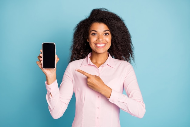 Photo of lady holding telephone indicating finger
