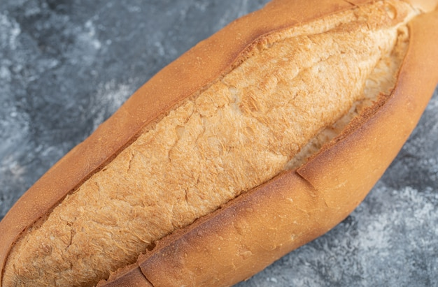 Photo of loaf of bread on grey background. high quality photo