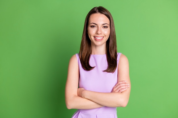 Photo of lovely attractive young woman lady beaming smile look camera advert startup freelance work international company wear violet dress isolated pastel green color background