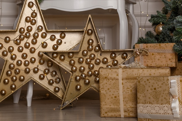 Photo of luxury gift boxes under christmas tree