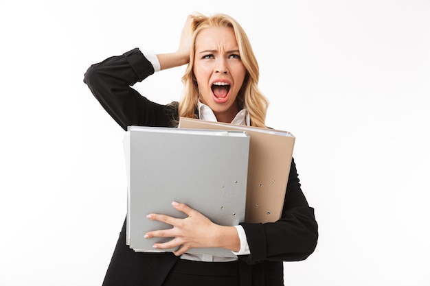 Photo of manager girl wearing office suit screaming while holding paper folders, isolated